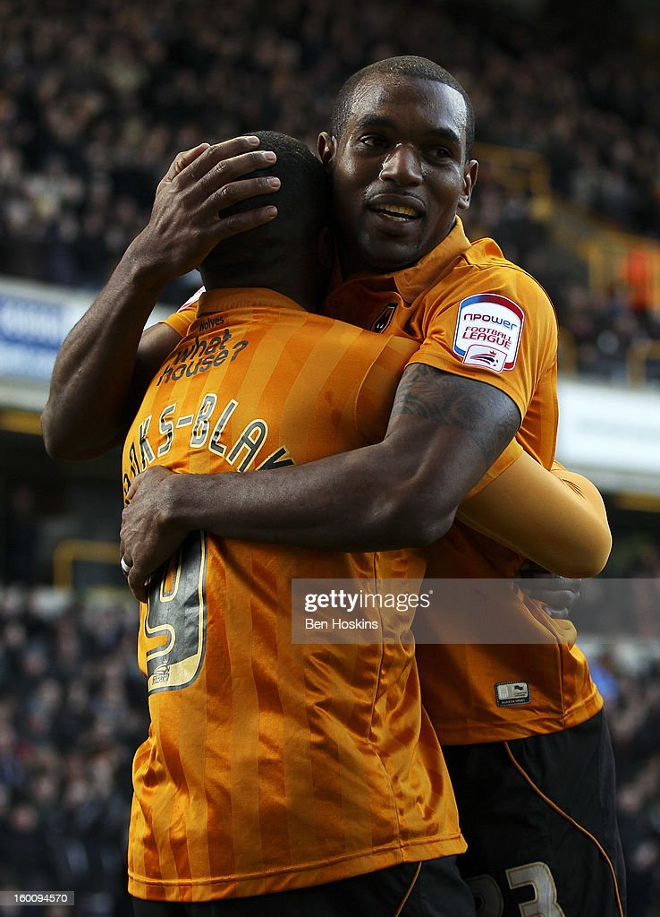Sylvan Ebanks-Blake of Wolves celebrates with team mates after scoring the opening goal of the game during the npower Championship match between Wolverhampton Wanderers and Blackpool at Molineux on January 26, 2013 in Wolverhampton, England.