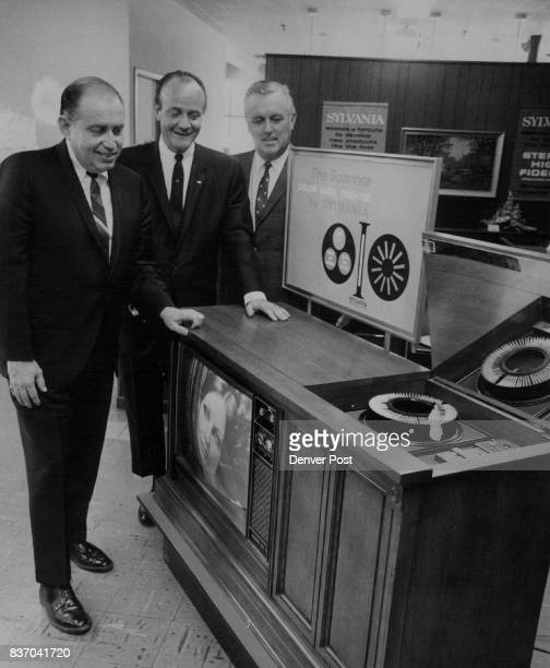 Sylvania 'Scanner' Shown Admiring the new 'Scanner Color Slide Theatre' at Boyd Distributing Co are from left Bill M Reynolds of Batavia NY special...