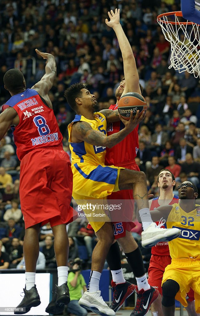 Sylven Landesberg, #15 of Maccabi Fox Tel Aviv competes with Viacheslav Kravtsov, #15 and Demetris Nichols, #8 of CSKA Moscow during the Turkish Airlines Euroleague Basketball Regular Season Date 1 game CSKA Moscow v Maccabi Tel Aviv at USH CSKA on October 15, 2015 in Moscow, Russia.