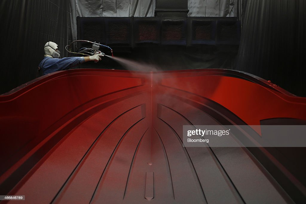 Sylvester Castillo applies a gel coat to an inboard speed boat mold at the Mastercraft Boat Co. factory in Vonore, Tennessee, U.S. on Tuesday, Feb. 4, 2014. Orders for U.S. factory goods, excluding transportation, rose .2 percent in December, according to data released by the Census Bureau. Photographer: Luke Sharrett/Bloomberg via Getty Images
