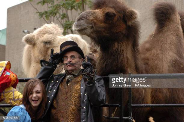 Sylvester McCoy as 'King Rat' and Cassandra Compton as 'Alice Fitzwarren' meet two camels at a preview of the pantomime 'Dick Whittington and his...