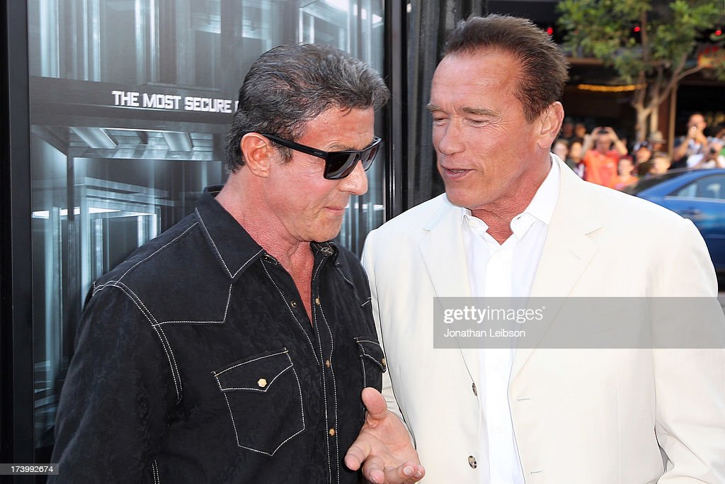 Sylvester Stallone and Arnold Schwarzenegger attend the 'Escape Plan' Premiere - Comic-Con International 2013 at Reading Cinemas Gaslamp on July 18, 2013 in San Diego, California.
