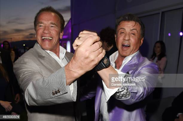 Sylvester Stallone and Arnold Schwarzenegger attend the Expendables 3 Dinner and Party sponsored by MATCHLESS on May 18 2014 in Cannes France