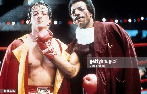 Sylvester Stallone and Carl Weathers on set of the film 'Rocky' 1976