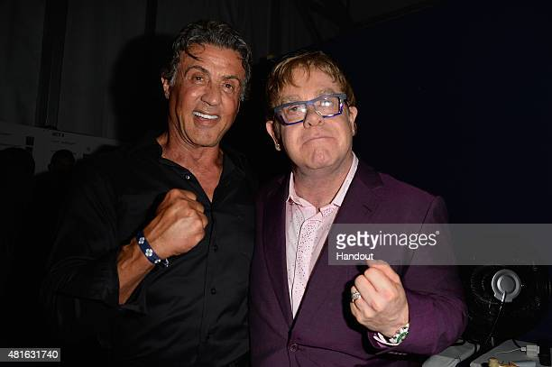 Sylvester Stallone and Elton John attend a cocktail reception during The Leonardo DiCaprio Foundation 2nd Annual SaintTropez Gala at Domaine Bertaud...