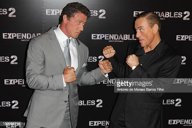 Sylvester Stallone and JeanClaude Van Damme attend 'The Expendables 2' at Le Grand Rex on August 9 2012 in Paris France