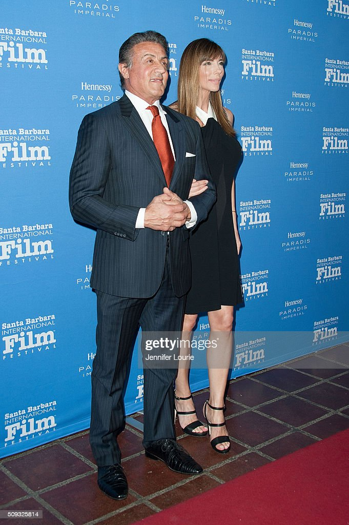 <a gi-track='captionPersonalityLinkClicked' href=/galleries/search?phrase=Sylvester+Stallone&family=editorial&specificpeople=202604 ng-click='$event.stopPropagation()'>Sylvester Stallone</a> and <a gi-track='captionPersonalityLinkClicked' href=/galleries/search?phrase=Jennifer+Flavin&family=editorial&specificpeople=206896 ng-click='$event.stopPropagation()'>Jennifer Flavin</a> arrive at the presentation of the Montecito Award for The 31st Santa Barbara International Film Festival at the Arlington Theatre on February 9, 2016 in Santa Barbara, California.