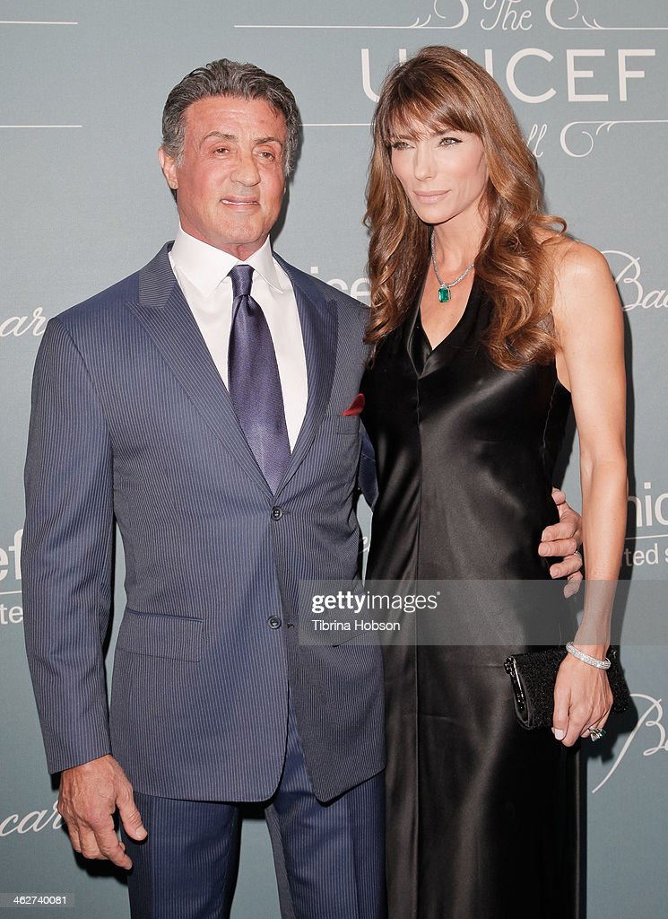 <a gi-track='captionPersonalityLinkClicked' href=/galleries/search?phrase=Sylvester+Stallone&family=editorial&specificpeople=202604 ng-click='$event.stopPropagation()'>Sylvester Stallone</a> AND <a gi-track='captionPersonalityLinkClicked' href=/galleries/search?phrase=Jennifer+Flavin&family=editorial&specificpeople=206896 ng-click='$event.stopPropagation()'>Jennifer Flavin</a> attend the 2014 UNICEF ball presented by Baccarat at Regent Beverly Wilshire Hotel on January 14, 2014 in Beverly Hills, California.