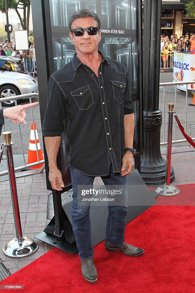 <a gi-track='captionPersonalityLinkClicked' href=/galleries/search?phrase=Sylvester+Stallone&family=editorial&specificpeople=202604 ng-click='$event.stopPropagation()'>Sylvester Stallone</a> attends the 'Escape Plan' Premiere - Comic-Con International 2013 at Reading Cinemas Gaslamp on July 18, 2013 in San Diego, California.