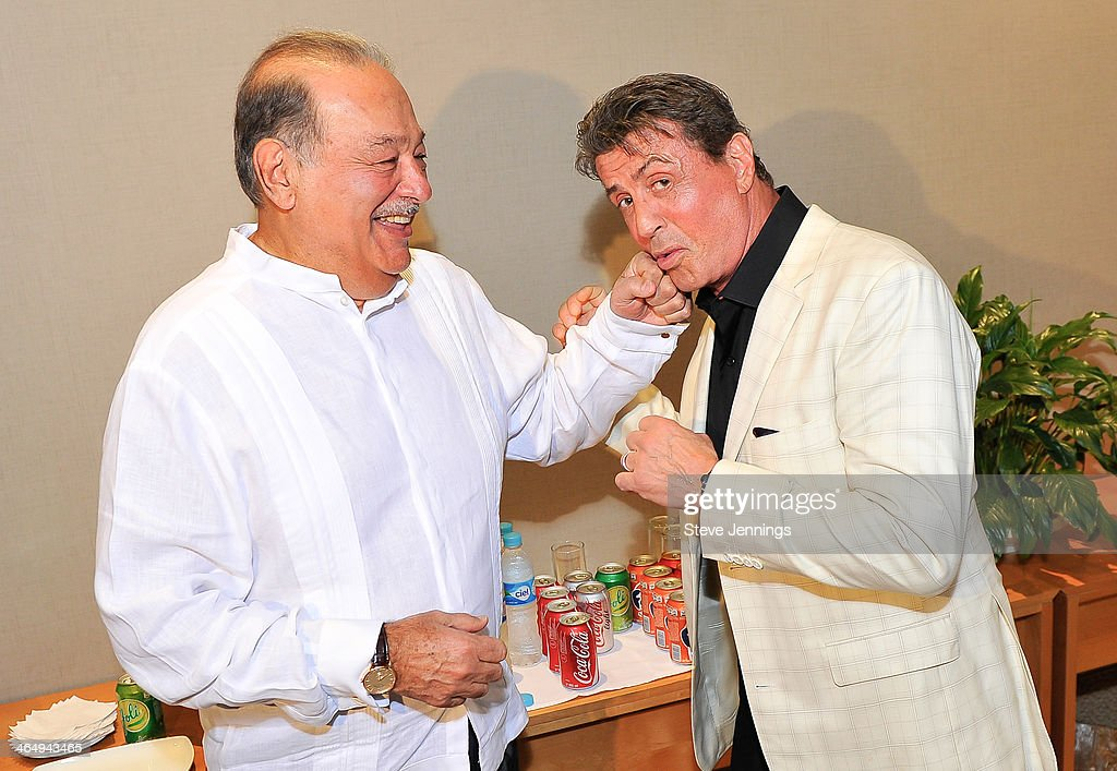 <a gi-track='captionPersonalityLinkClicked' href=/galleries/search?phrase=Sylvester+Stallone&family=editorial&specificpeople=202604 ng-click='$event.stopPropagation()'>Sylvester Stallone</a> having fun with <a gi-track='captionPersonalityLinkClicked' href=/galleries/search?phrase=Carlos+Slim&family=editorial&specificpeople=584959 ng-click='$event.stopPropagation()'>Carlos Slim</a>, the richest man in the world,before being honored at the 9th Annual Acapulco Film Festival. The powerful duo discussed bringing new film projects to Mexico on January 24, 2014, in Acapulco, Mexico.
