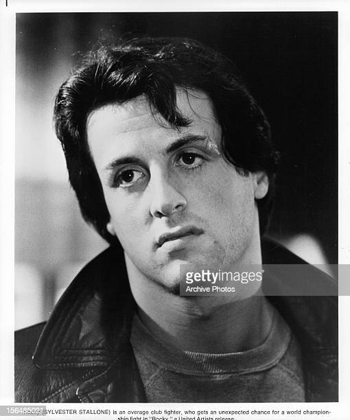 Sylvester Stallone looks unamused in a scene from the film 'Rocky' 1976