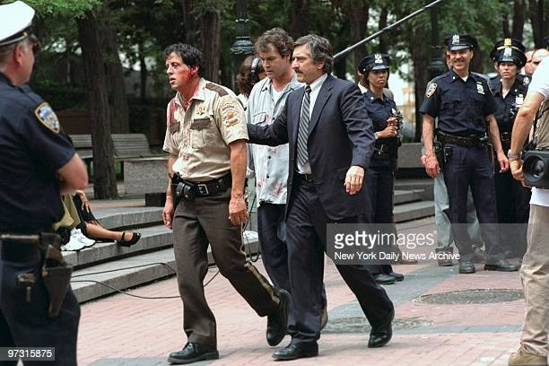Sylvester Stallone Ray Liotta and Robert De Niro during filming of the movie 'Copland' at Police Headquarters