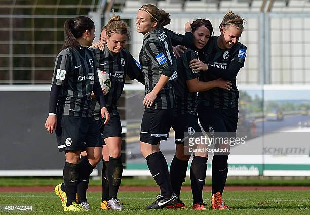 Sylvia Arnold of Freiburg celebrates her team's third goal with team mates during the Women's DFB Cup Quarter Final match between SC Freiburg and FSV...
