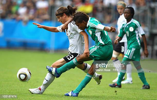 Sylvia Arnold of Germany and Esther Sunday of Nigeria compete for the ball during the 2010 FIFA Women's World Cup Final match between Germany and...
