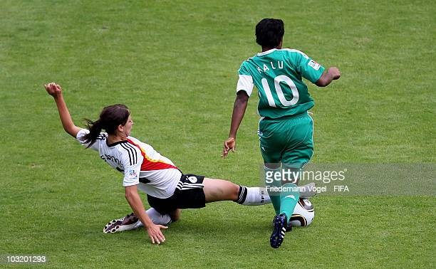 Sylvia Arnold of Germany and Rebecca Kalu of Nigeria battle for the ball during the FIFA U20 Women's World Cup Final match between Germany and...