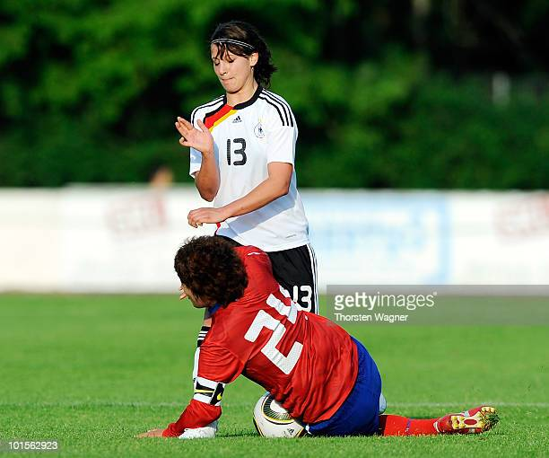 Sylvia Arnold of Germany battles for the ball with Kim Narae of South Korea during the U20 international friendly match between Germany and South...