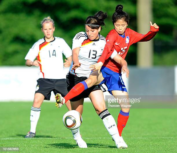 Sylvia Arnold of Germany battles for the ball with Lee Mina of South Korea during the U20 international friendly match between Germany and South...