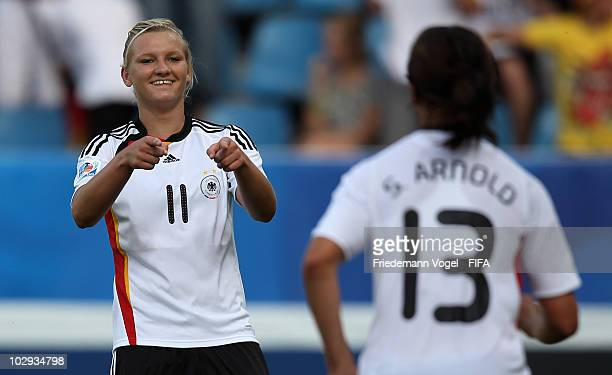 Sylvia Arnold of Germany celebrates scoring the second goal with Alexandra Popp during the FIFA U20 Women's World Cup Group A match between Germany...