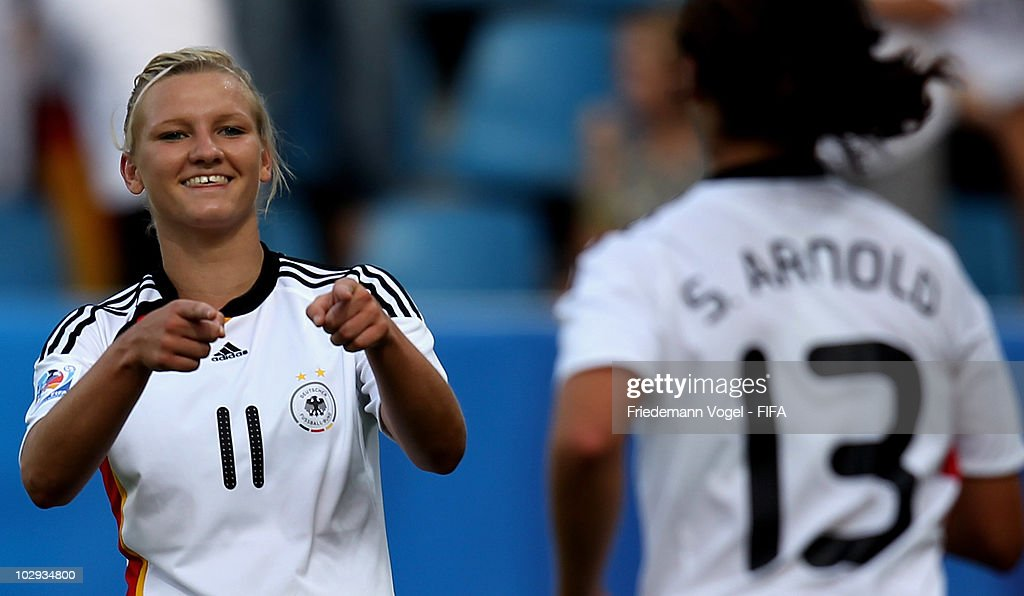 Sylvia Arnold (13) of Germany celebrates scoring the second goal with Alexandra Popp (11) during the FIFA U20 Women's World Cup Group A match between Germany and Colombia at the FIFA U-20 Women's Worl Cup stadium on July 16, 2010 in Bochum, Germany.