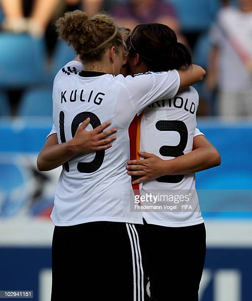 Sylvia Arnold of Germany celebrates scoring the second goal with Alexandra Popp and Kim Kulig during the FIFA U20 Women's World Cup Group A match...
