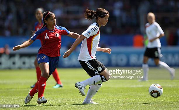 Sylvia Arnold of Germany in action with Mariela Campos of Costa Rica during the FIFA U20 Women's World Cup Group A match between Germany and Costa...