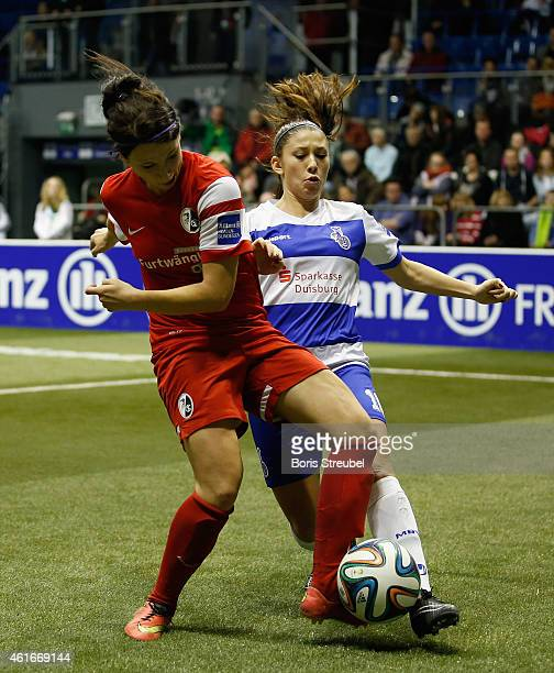 Sylvia Arnold of SC Freiburg battles for the ball with Carmen Pulver of MSV Duisburg during the DFB Women's Indoor Football Cup 2015 match between...
