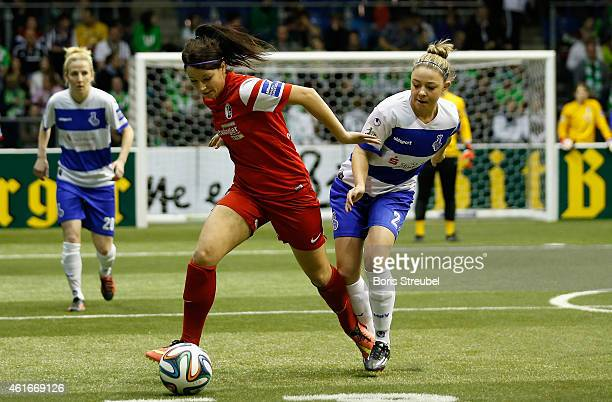 Sylvia Arnold of SC Freiburg battles for the ball with Isabel Schenk of MSV Duisburg during the DFB Women's Indoor Football Cup 2015 match between...