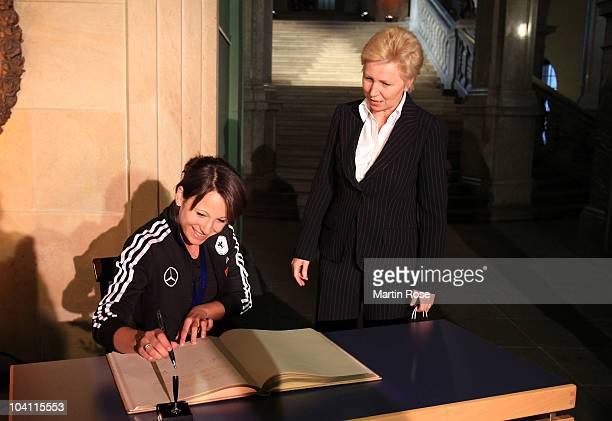 Sylvia Arnold signs the Golden Book of the city at the Rathaus during their visit of the city Dresden on September 15 2010 in Dresden Germany