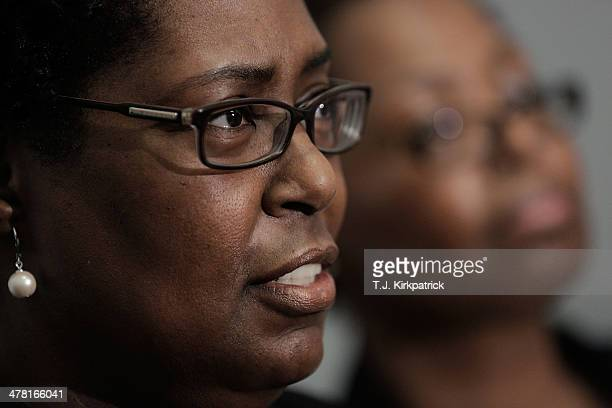 Sylvia Carver left with her sister Veronica Carver who lost their sister in the September 2001 terrorist attacks speaks during a press conference on...
