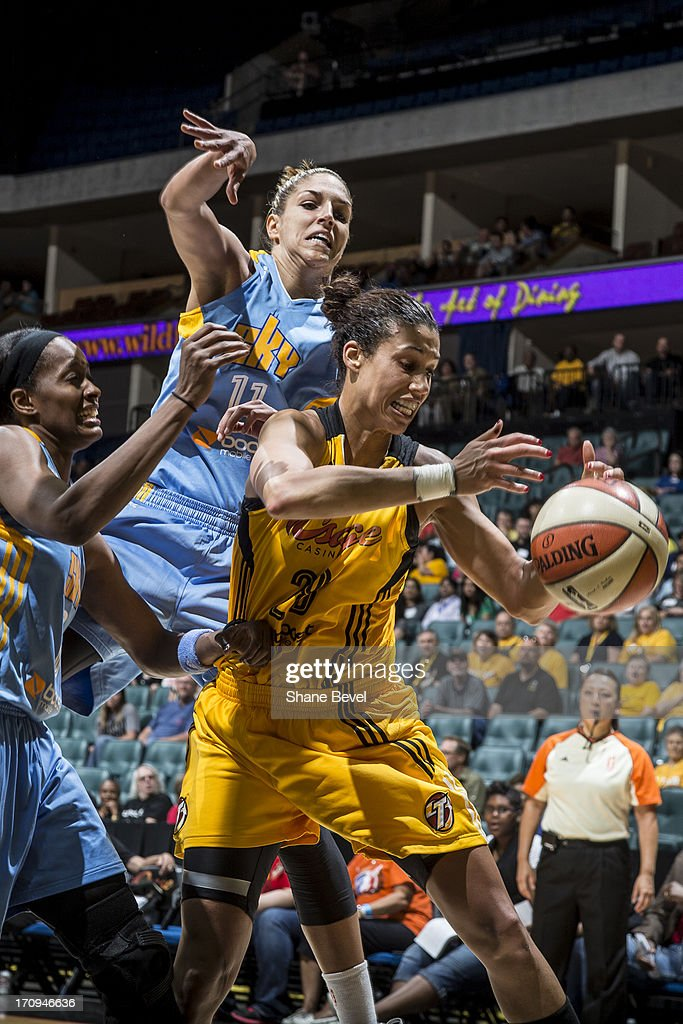 Sylvia Fowles #34 and Elena Delle Donne #11 of the Chicago Sky battle for a loose ball with Nicole Powell #28 of the Tulsa Shock during the WNBA game on June 20, 2013 at the BOK Center in Tulsa, Oklahoma.