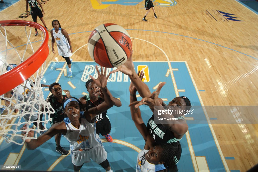 <a gi-track='captionPersonalityLinkClicked' href=/galleries/search?phrase=Sylvia+Fowles+-+Basketball+Player&family=editorial&specificpeople=707903 ng-click='$event.stopPropagation()'>Sylvia Fowles</a> #34 of the Chicago Sky battles for a rebound with Shanece McKinney #24 and Tina Charles #31 of the New York Liberty during the game on July 31, 2014 at Allstate Arena in Rosemont, Illinois.