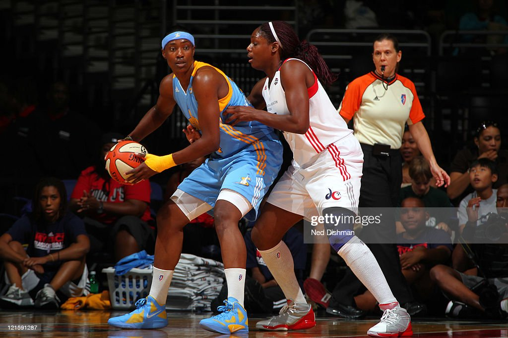 Sylvia Fowles of the Chicago Sky drives against Nicky Anosike of the Washington Mystics at the Verizon Center on August 20 2011 in Washington DC NOTE...