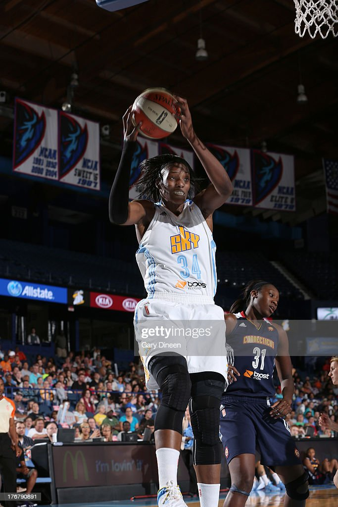 <a gi-track='captionPersonalityLinkClicked' href=/galleries/search?phrase=Sylvia+Fowles&family=editorial&specificpeople=707903 ng-click='$event.stopPropagation()'>Sylvia Fowles</a> #34 of the Chicago Sky grabs a rebound during the game against the Connecticut Sun on August 18, 2013 at the Allstate Arena in Rosemont, Illinois.