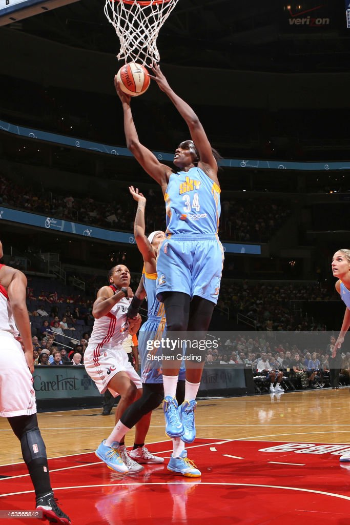 Sylvia Fowles #34 of the Chicago Sky rebounds against Ivory Latta #12 of the Washington Mystics at the Verizon Center on August 13, 2014 in Washington, DC.