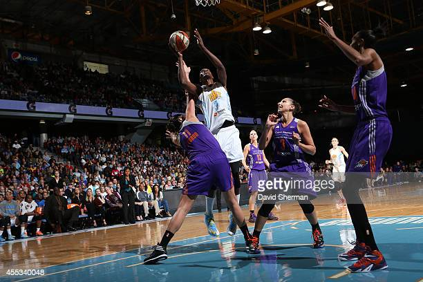 Sylvia Fowles of the Chicago Sky shoots against Ewelina Kobryn of the Phoenix Mercury in Game Three of the 2014 WNBA Finals on September 12 2014 at...