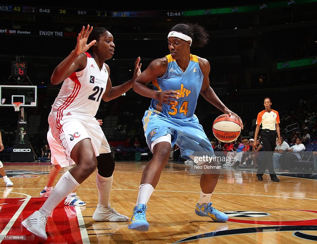 Sylvia Fowles of the Chicago Sky shoots against Nicky Anosike of the Washington Mystics at the Verizon Center on May 26 2011 in Washington DC NOTE TO...