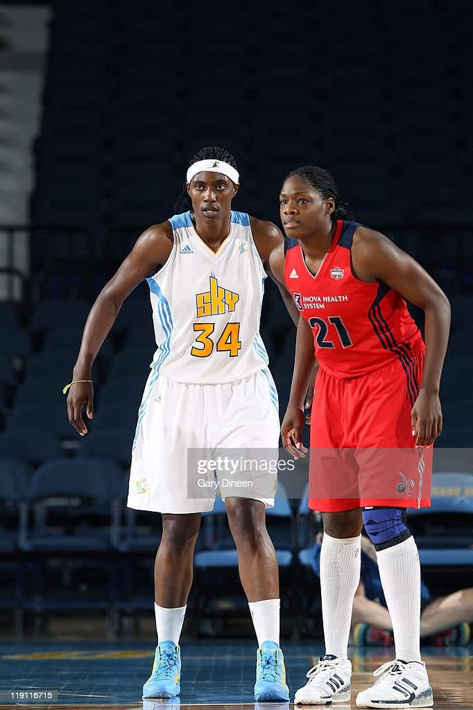 Sylvia Fowles of the Chicago Sky stands next to Nicky Anosike of the Washington Mystics during the WNBA game on July 5 2011 at the AllState Arena in...