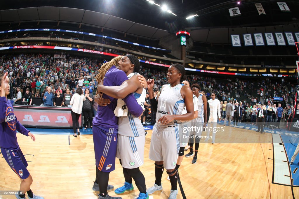 Sylvia Fowles #34 of the Minnesota Lynx and Brittney Griner #42 of the Phoenix Mercury hug after the game on August 22, 2017 at Xcel Energy Center in St. Paul, Minnesota.