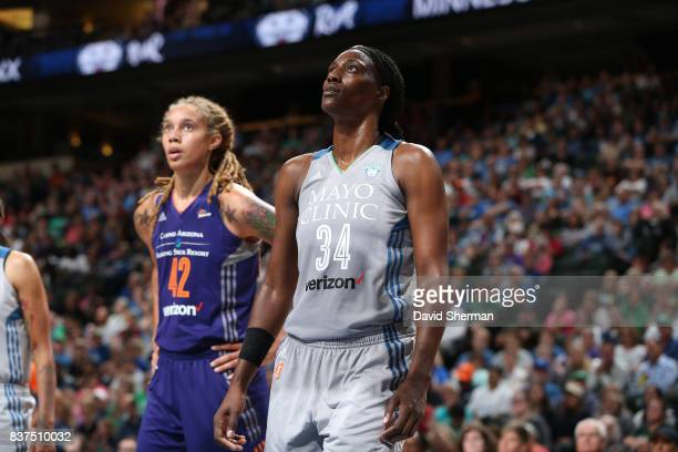 Sylvia Fowles of the Minnesota Lynx and Brittney Griner of the Phoenix Mercury react to a play during the game on August 22 2017 at Xcel Energy...