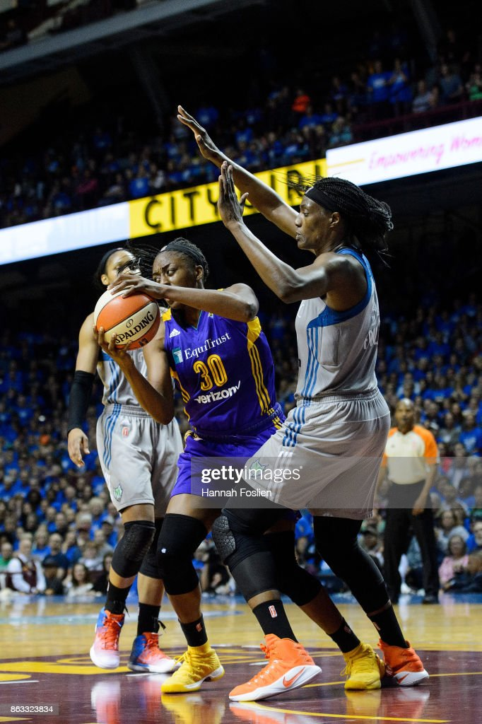 Sylvia Fowles #34 of the Minnesota Lynx defends against Nneka Ogwumike #30 of the Los Angeles Sparks during the fourth quarter of Game Two of the WNBA Finals on September 26, 2017 at Williams in Minneapolis, Minnesota. The Lynx defeated the Sparks 70-68.