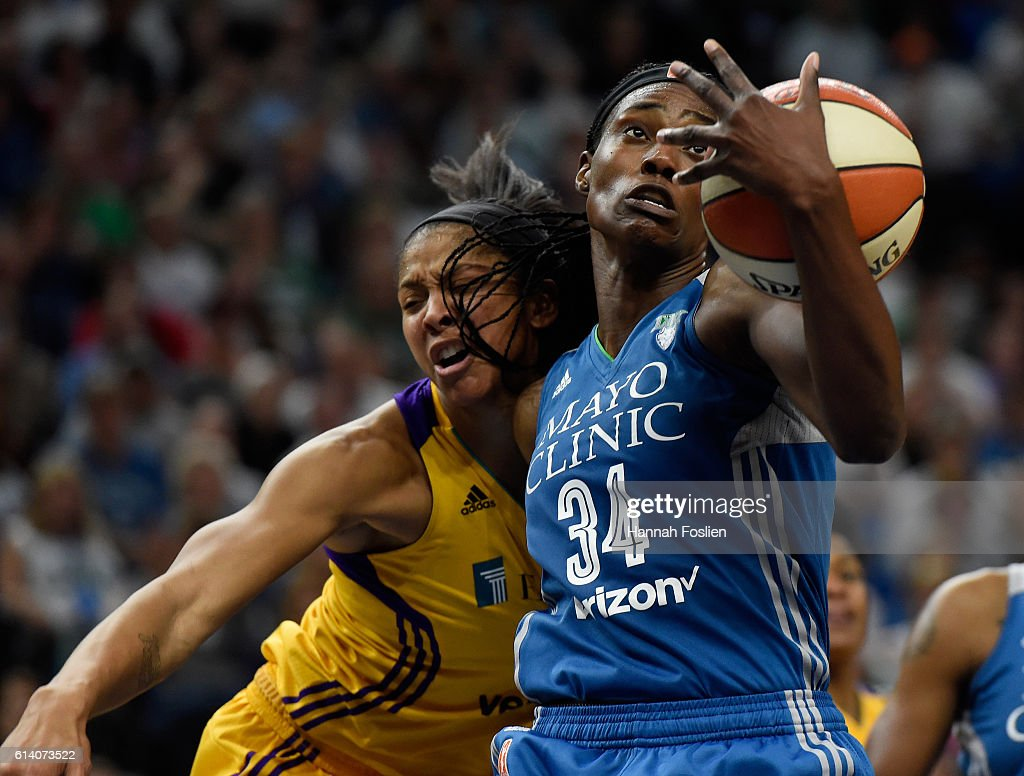Sylvia Fowles #34 of the Minnesota Lynx pulls in a defensive rebound against Candace Parker #3 of the Los Angeles Sparks during the fourth quarter in Game Two of the 2016 WNBA Finals on October 11, 2016 at Target Center in Minneapolis, Minnesota. The Lynx defeated the Sparks 79-60.