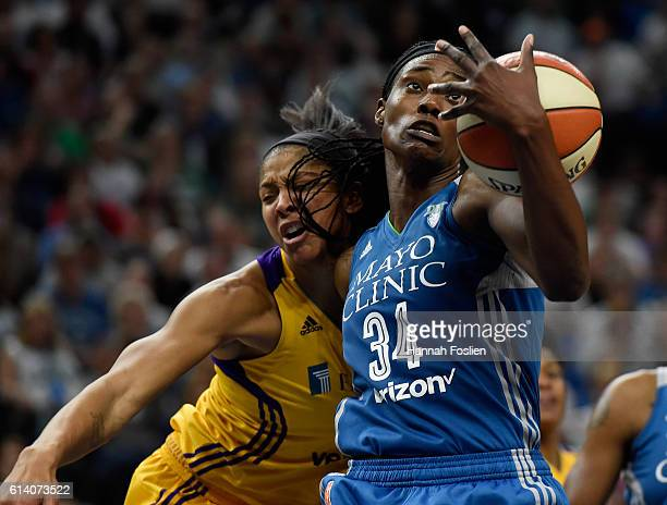 Sylvia Fowles of the Minnesota Lynx pulls in a defensive rebound against Candace Parker of the Los Angeles Sparks during the fourth quarter in Game...
