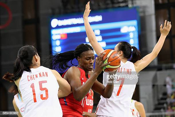 Sylvia Fowles of United States puts up a shot in front of Nan Chen and Ting Shao during the Womens Preliminary Round on Day 9 of the 2016 Rio...
