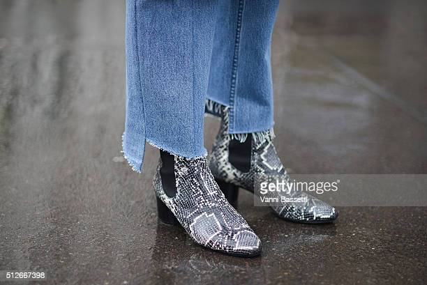 Sylvia Haghjoo poses wearing Vetements pants and Isabel Marant shoes before the Jil Sander show during the Milan Fashion Week Fall/Winter 2016/17 on...