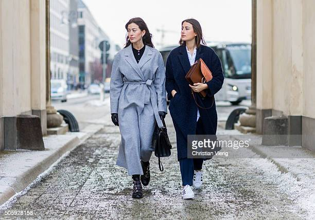 Sylvia Haghjoo wearing coat Marc Cain shoes Givenchy blouse Paul Joe jeans Adriano Goldschmied jewellery Georg Jensen bag Chloe and Julia Haghjoo...