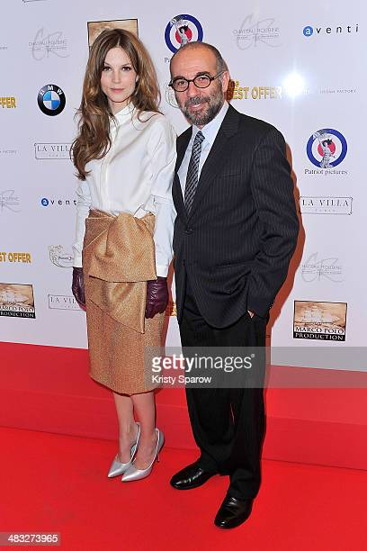 Sylvia Hoeks and Giuseppe Tornatore attend the 'The Best Offer' Paris Premiere at Publicis Champs Elysees on April 7 2014 in Paris France