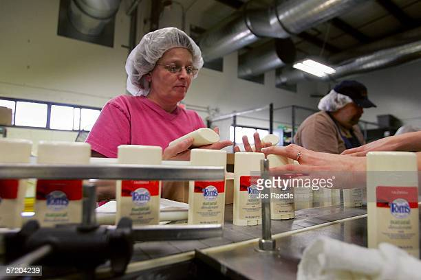 Sylvia Moore works on the Tom's of Maine deodorant assembly line in the manufacturing plant March 28 2006 in Sanford Maine The ColgatePalmolive...