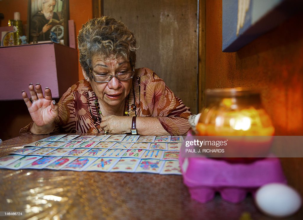 Sylvia Quintero, an astrologist and Tarot card reader, shares her visions on politics and the future from her home in a special room for card reading on June 16, 2012, in Cabo San Lucas, BCS, Mexico, the site of the G-20 Summit June 18-20, 2012. AFP Photo/Paul J. Richards