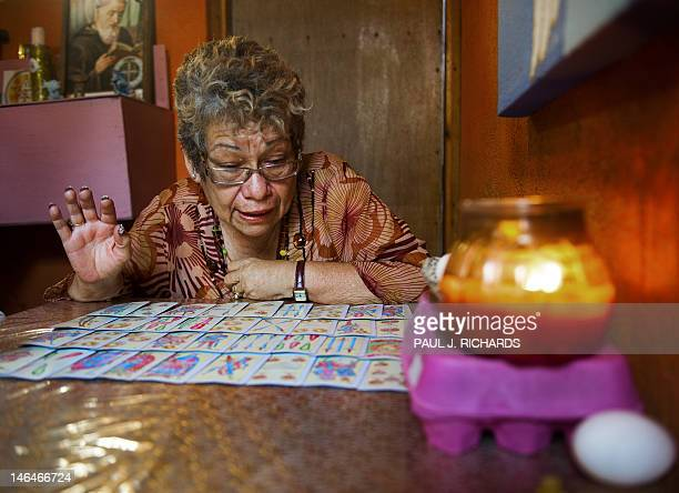 Sylvia Quintero an astrologist and Tarot card reader shares her visions on politics and the future from her home in a special room for card reading...