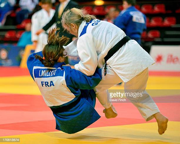 Sylvia Strube of Germany sweeps the legs from under Isabele Millot of France to score an ippon in 41 seconds on her way to the F5 gold medal during...